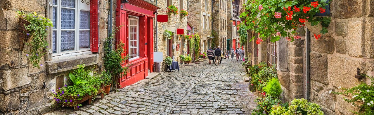 Idyllic scene of traditional houses in narrow alley in an old town in Europe
